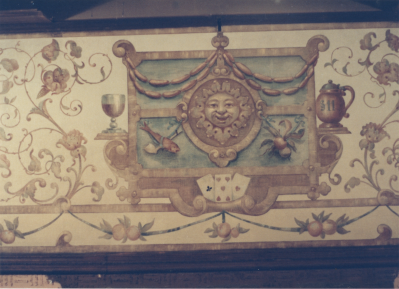 The mural behind the large sideboard in the Bierstube! A smiling sun, surrounded by links of sausages and drinks